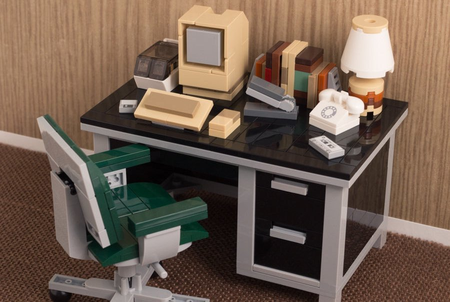Photo: A retro-looking desk with an old Mac sitting atop it, all cunningly made out of LEGOs.